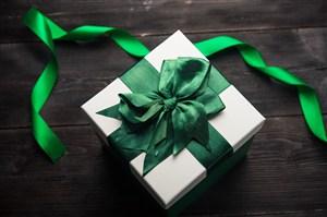 绿色绸带礼品包装盒高清图片
